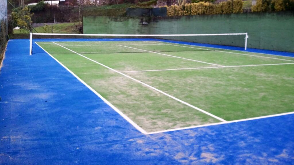 Pista de tenis en césped artificial Nigrán